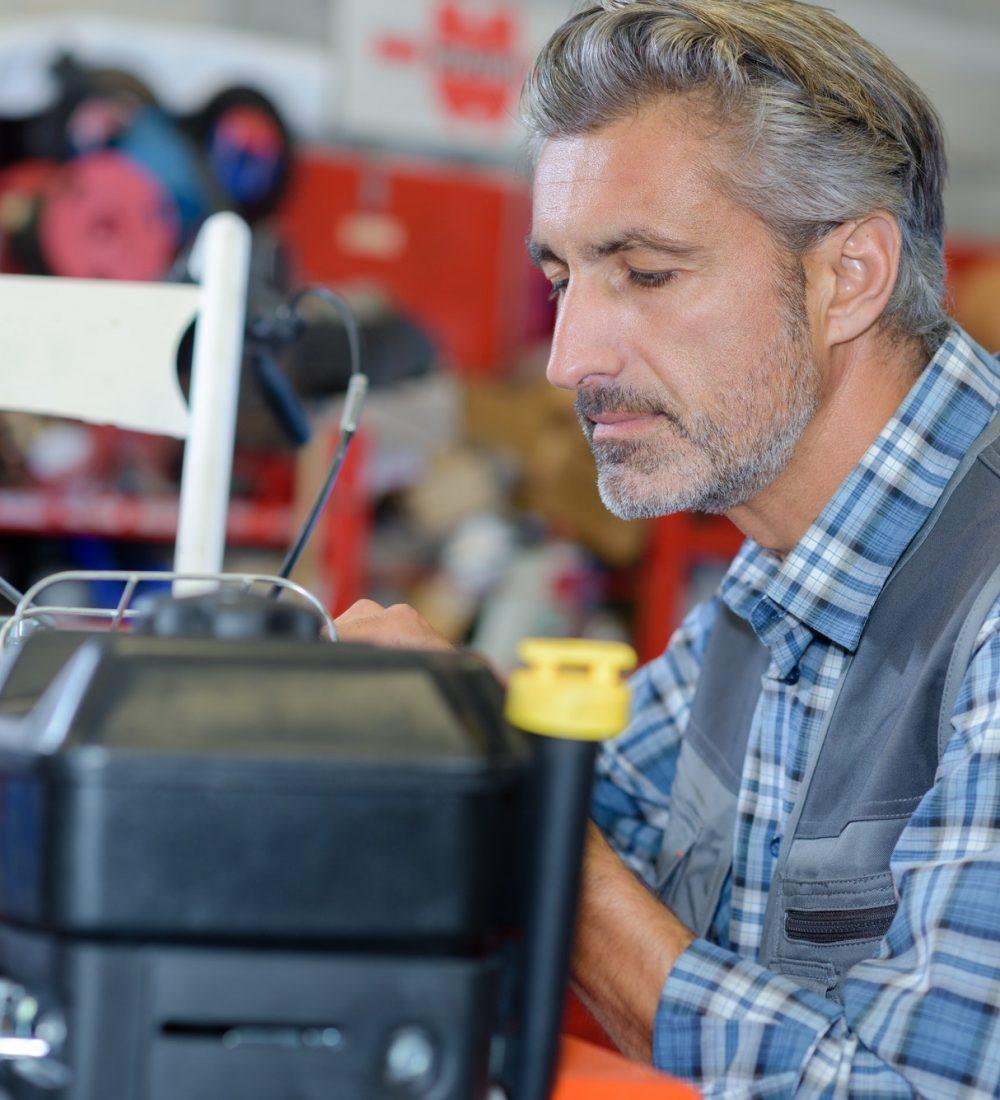 Mechanic working on lawnmower